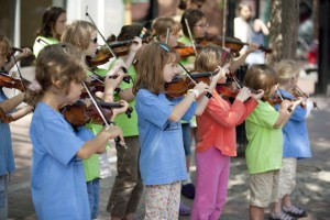 Children's Violin Ensemble at a Street Performance